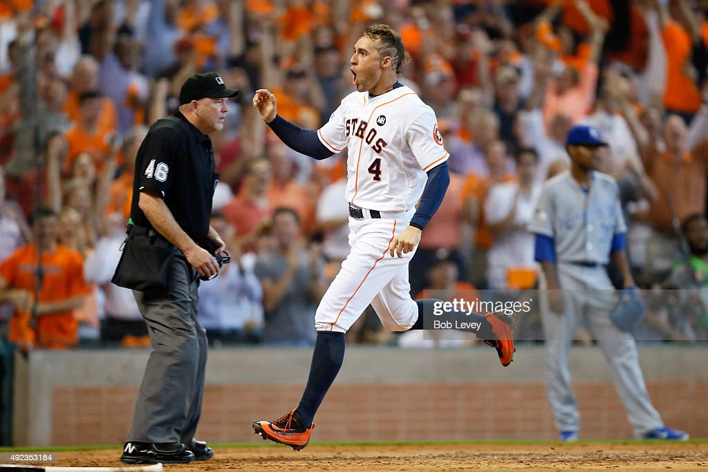 George Springer #4 of the Houston Astros reacts after scoring the go ahead run on an RBI double in the fifth inning against the Kansas City Royals during game four of the American League Divison Series at Minute Maid Park on October 12, 2015 in Houston, Texas.