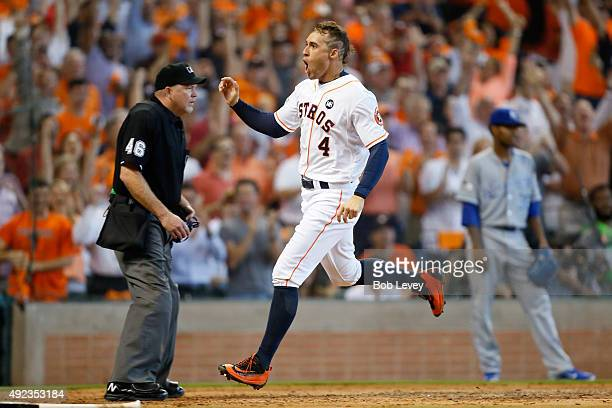 George Springer of the Houston Astros reacts after scoring the go ahead run on an RBI double in the fifth inning against the Kansas City Royals...