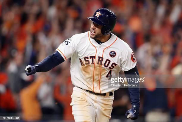 George Springer of the Houston Astros reacts as he hits a solo home run during the seventh inning against the Los Angeles Dodgers in game five of the...