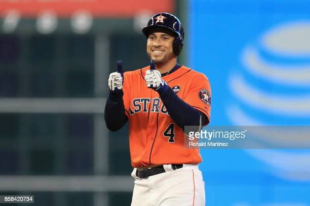 George Springer of the Houston Astros reacts on second base after hitting a double in the fourth inning against the Boston Red Sox during game two of...
