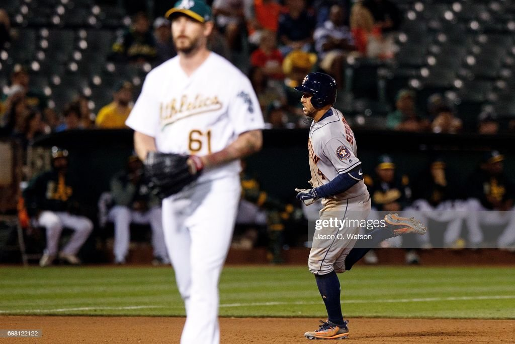 George Springer #4 of the Houston Astros rounds the bases after hitting a home run off of John Axford #61 of the Oakland Athletics during the eighth inning at the Oakland Coliseum on June 19, 2017 in Oakland, California. The Houston Astros defeated the Oakland Athletics 4-1.