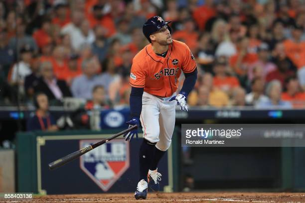 George Springer of the Houston Astros runs after hitting a solo home run in the third inning against the Boston Red Sox during game two of the...
