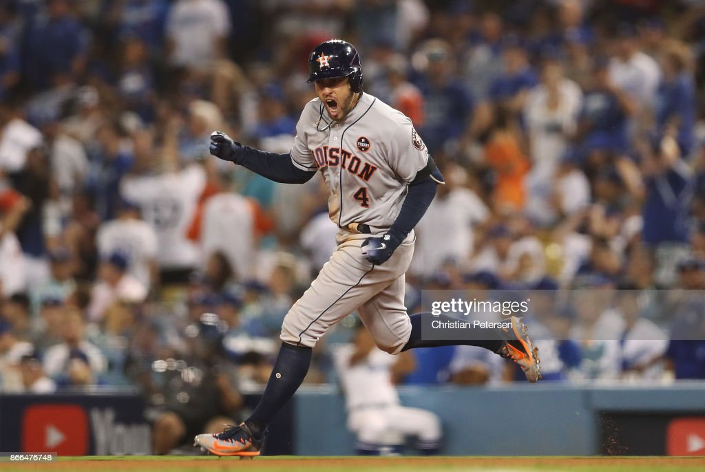 George Springer #4 of the Houston Astros runs the bases after hitting a two-run home run during the eleventh inning against the Los Angeles Dodgers in game two of the 2017 World Series at Dodger Stadium on October 25, 2017 in Los Angeles, California.