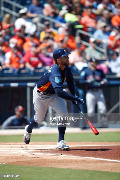 George Springer of the Houston Astros runs to first base on contact a spring training game against the Washington Nationals at FITTEAM Ballpark on...