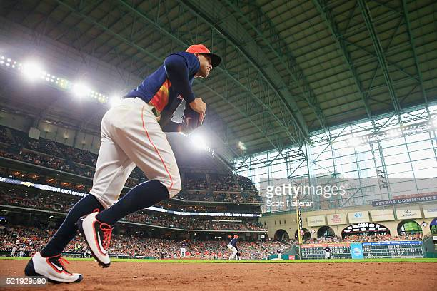 George Springer of the Houston Astros runs to the field to start the seventh inning of their game against the Detroit Tigers at Minute Maid Park on...