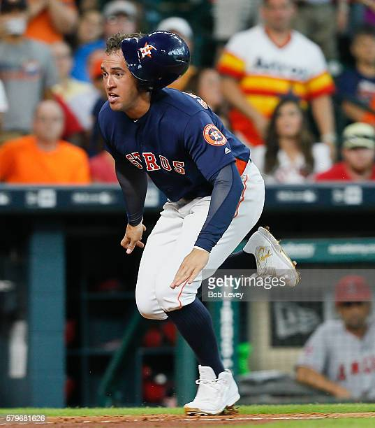 George Springer of the Houston Astros scores in the fifth inning against the Los Angeles Angels of Anaheim at Minute Maid Park on July 24 2016 in...