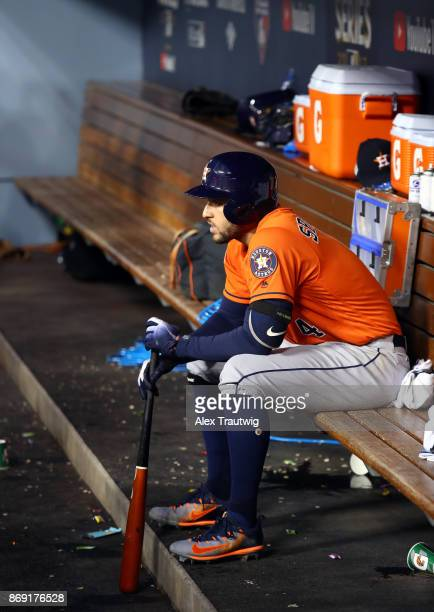 George Springer of the Houston Astros sits in the dugout during Game 7 of the 2017 World Series against the Los Angeles Dodgers at Dodger Stadium on...