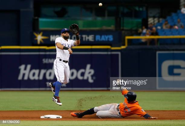 George Springer of the Houston Astros slides into second base ahead of second baseman Rougned Odor of the Texas Rangers before being called out on...