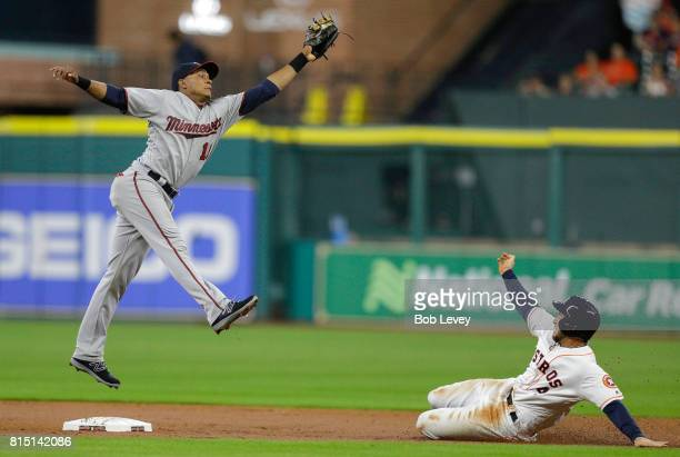 George Springer of the Houston Astros steals second base in the second inning as Jorge Polanco of the Minnesota Twins reaches for the high throw at...