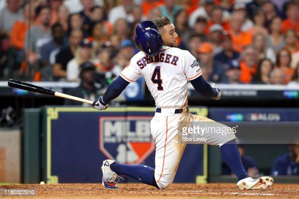 George Springer of the Houston Astros strikes out against the Tampa Bay Rays during the seventh inning in game five of the American League Division...