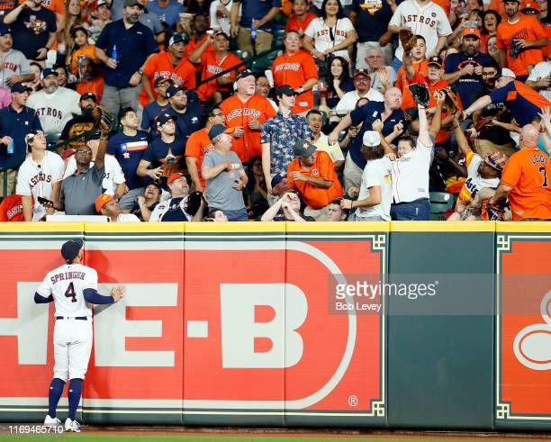 George Springer of the Houston Astros watches a home run by Ronny Rodriguez of the Detroit Tigers leave the park in the fifth inning at Minute Maid...