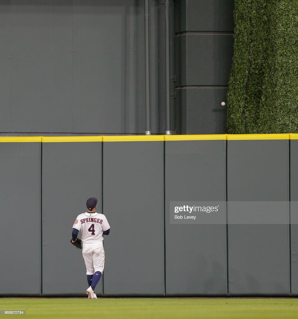 George Springer #4 of the Houston Astros watches the ball leave the park on a three-run home run off the bat of Gary Sanchez of the New York Yankees in the ninth inning at Minute Maid Park on May 1, 2018 in Houston, Texas.