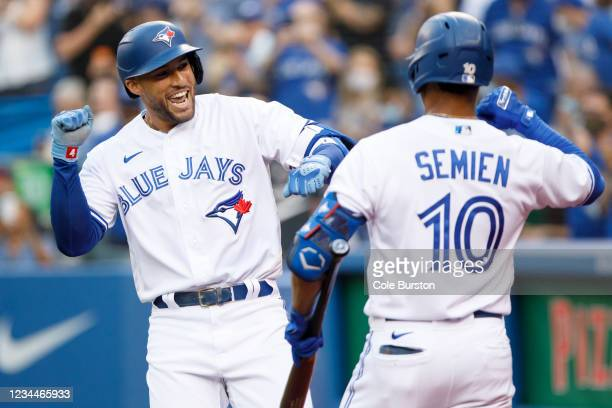 George Springer of the Toronto Blue Jays and Marcus Semien celebrate Springer's home run in the first inning of their MLB game against the Cleveland...