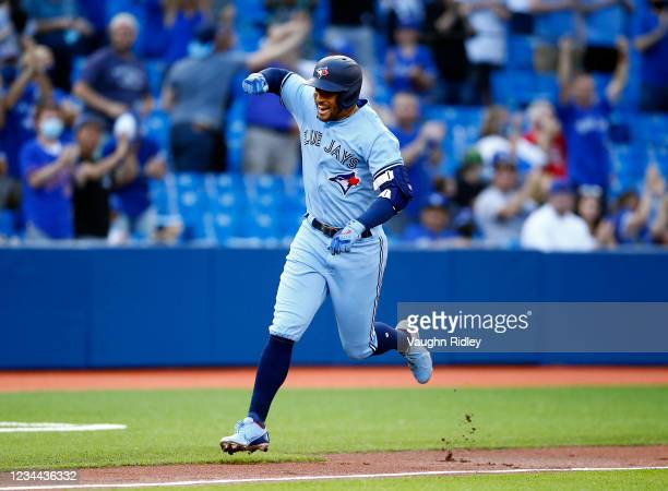 George Springer of the Toronto Blue Jays celebrates after hitting a home run in the first inning during a MLB game against the Cleveland Indians at...