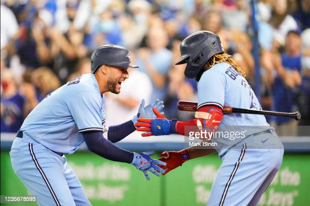 George Springer of the Toronto Blue Jays celebrates his home run with teammate Vladimir Guerrero Jr. #27 in the first inning during their MLB game...
