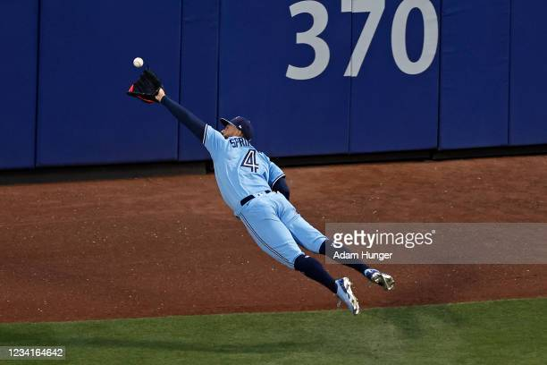 George Springer of the Toronto Blue Jays makes a diving catch on a ball off the bat of Brandon Nimmo of the New York Mets during the third inning at...