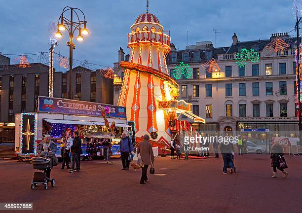george square, glasgow. helter skelter, christmas stall - george square stock photos and pictures