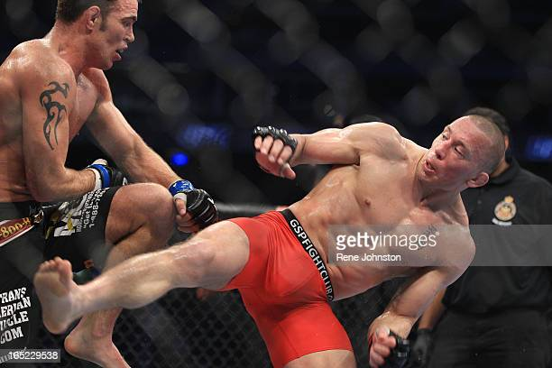 George St Pierre of Montreal gets tangled up in the legs of Jake Sheilds of California at UFC 129