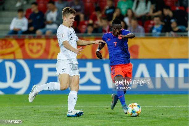 George Stanger of New Zealand and Ivan Angulo of Colombia battle for the ball during the 2019 FIFA U20 World Cup Round of 16 match between Colombia...