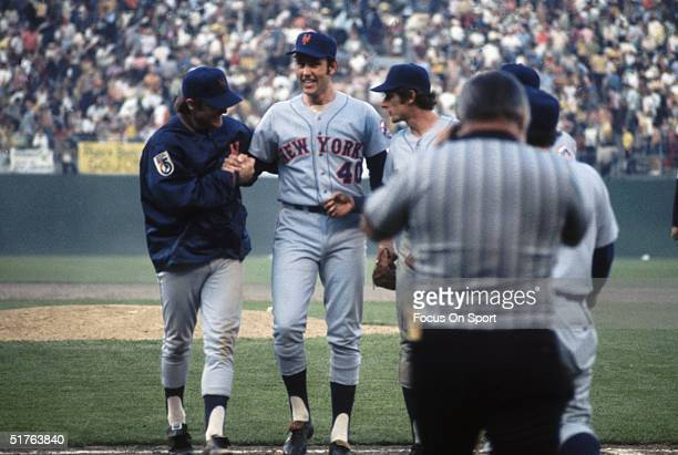George Stone of the New York Mets is congratulated by Tug McGraw and George Stone at home plate after a Mets victory circa 1970's