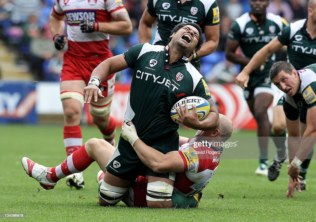 George Stowers of London Irish grimaces as Mike Tindall tackles during the Aviva Premiership match between London Irish and Gloucester at the Madejski Stadium on September 19, 2010 in Reading, England.