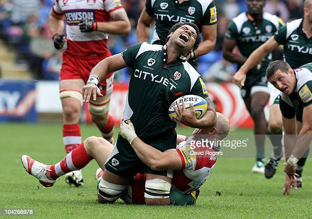 George Stowers of London Irish grimaces as Mike Tindall tackles during the Aviva Premiership match between London Irish and Gloucester at the...