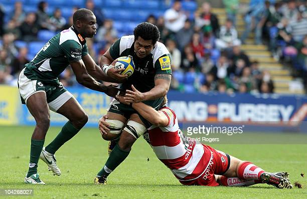 George Stowers of London Irish is tackled by Rupert Harden during the Aviva Premiership match between London Irish and Gloucester at the Madejski...