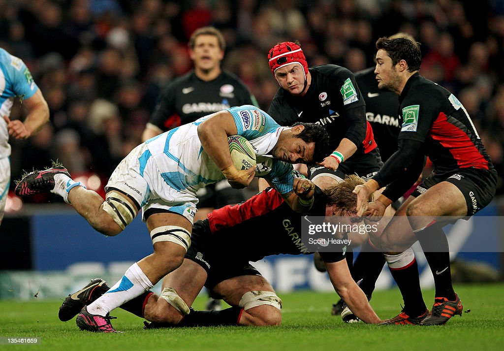 George Stowers of Ospreys is tackled by George Kruis of Saracens in action during the Heineken Cup Match between Saracens and Ospreys at Wembley Stadium on December 10, 2011 in London, England.