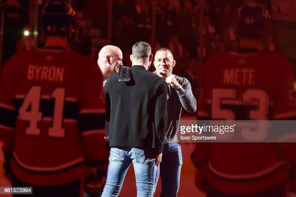 George StPierre facing UFC Michael Bisping at center ice prior to the Toronto Maple Leafs versus the Montreal Canadiens game on October 14 at Bell...