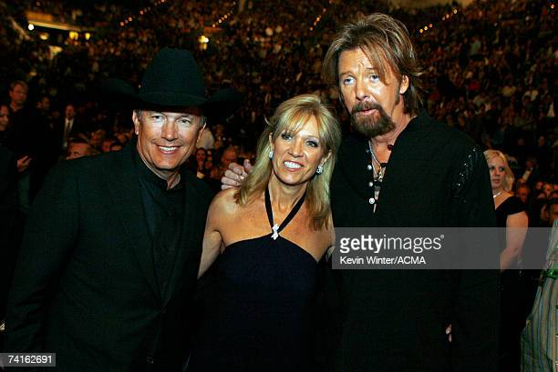 PRICING*** George Strait his wife Norma and Ronnie Dunn pose in the audience during the 42nd Annual Academy Of Country Music Awards held at the MGM...