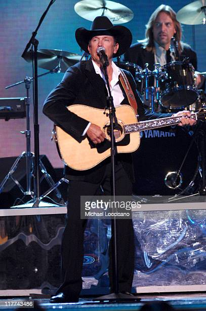 George Strait performs High Tone Woman during The 39th Annual CMA Awards Show at Madison Square Garden in New York City New York United States
