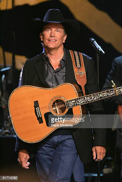 George Strait performs on stage at the 38th Annual CMA Awards at the Grand Ole Opry House November 9 2004 in Nashville Tennessee