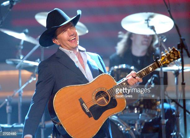 George Strait performs onstage at the 37th Annual CMA Awards at the Grand Ole Opry House November 5 2003 in Nashville Tennessee