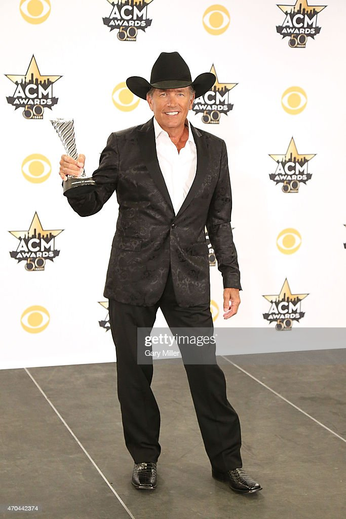 George Strait poses in the press room at the 50th Academy of Country Music Awards at AT&T Stadium on April 19, 2015 in Arlington, Texas.
