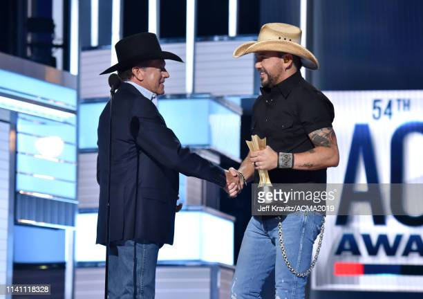 George Strait presents Jason Aldean with the Artist of the Decade Award during the 54th Academy Of Country Music Awards at MGM Grand Garden Arena on...