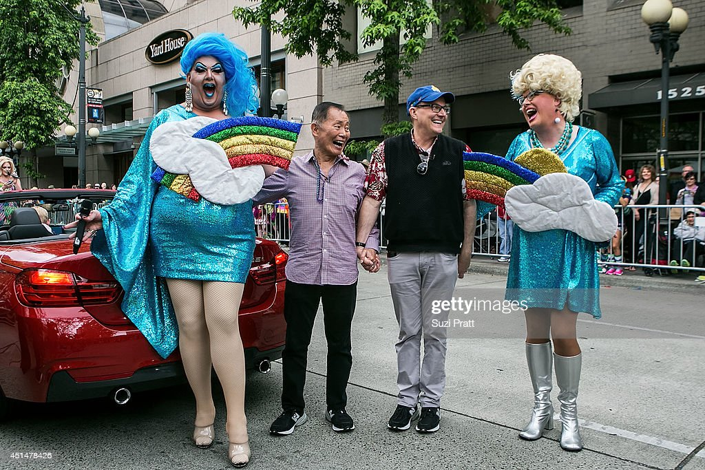 George Takei, Celebrity Grand Marshall of the 40th Annual Seattle Pride Parade and his husband Brad Altman pose with drag queens Mama Tits and Sylvia O'Stayformore on June 29, 2014 in Seattle, Washington.