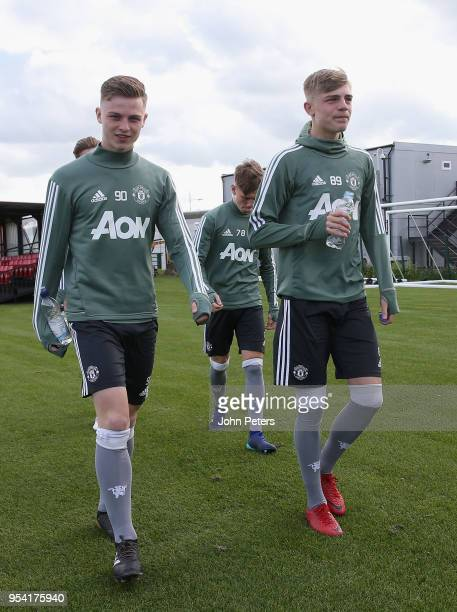 George Tanner and Brandon Williams of Manchester United U18s in action during an U18s training session at Aon Training Complex on May 2 2018 in...