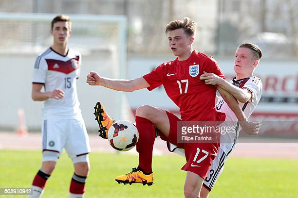 George Tanner of England challenges JanNiklas Beste of Germany during the UEFA Under17 match between U17 England v U17 Germany on February 7 2016 in...