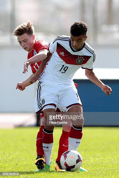 George Tanner of England challenges Timothy Tillman of Germany during the UEFA Under17 match between U17 England v U17 Germany on February 7 2016 in...