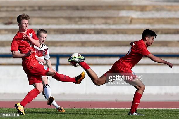 George Tanner Simranjit Thandi of England challenges JanNiklas Beste of Germany during the UEFA Under17 match between U17 England v U17 Germany on...