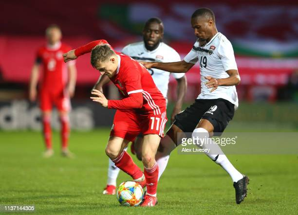 George Thomas of Wales battles for possession with Kevan George of Trinidad and Tobago during the International Friendly match between Wales and...