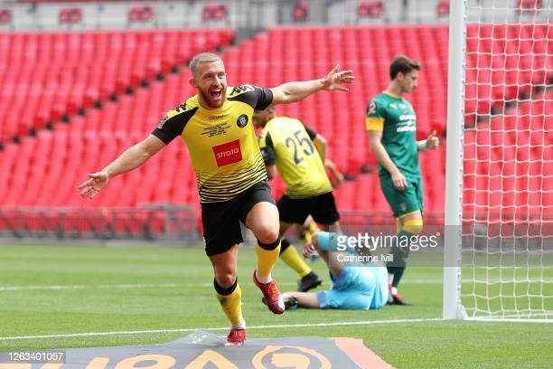 George Thomson of Harrogate Town celebrates after scoring his sides first goal during the Vanarama National League Play Off Final match between...