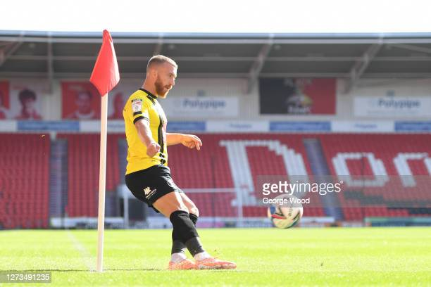 George Thomson of Harrogate Town takes a corner during the Sky Bet League Two match between Harrogate Town and Walsall at The Keepmoat Stadium on...