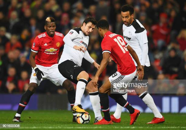 George Thorne and Tom Huddlestone of Derby County battle with Paul Pogba and Marcus Rashford of Manchester United during the Emirates FA Cup Third...