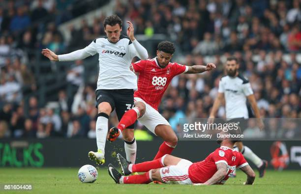 George Thorne of Derby County is tackled by Danny Fox and Liam Bridcutt of Nottingham Forest during the Sky Bet Championship match between Derby...