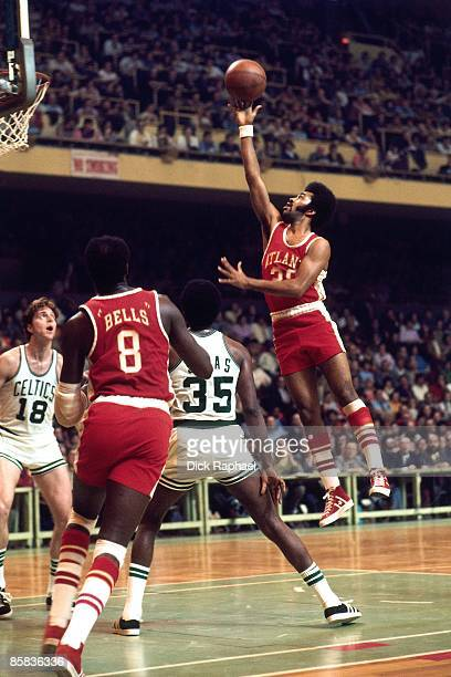 George Trapp of the Atlanta Hawks shoots a layup against the Boston Celtics during a game played in 1973 at the Boston Garden in Boston Massachusetts...
