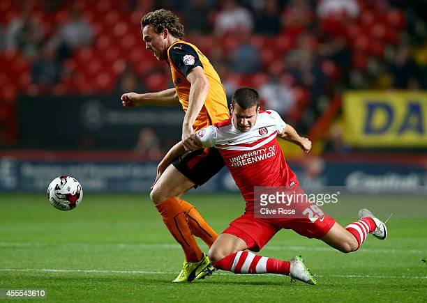 George Tucudean of Charlton Athletic is challenged by George Saville of Wolverhampton Wanderers during the Sky Bet Championship match between...