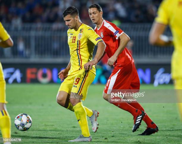 George Tucudean of Romania in action against Nemanja Matic of Serbia during the UEFA Nations League C group four match between Serbia and Romania at...