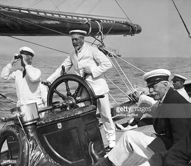 George V King of Great Britain at the helm of the yacht Britannia