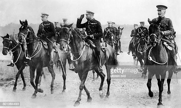 George V of he United Kingdom King of the UK of Great Britain 191036 Visit in Germany King George on horseback with his officers' staff 1913